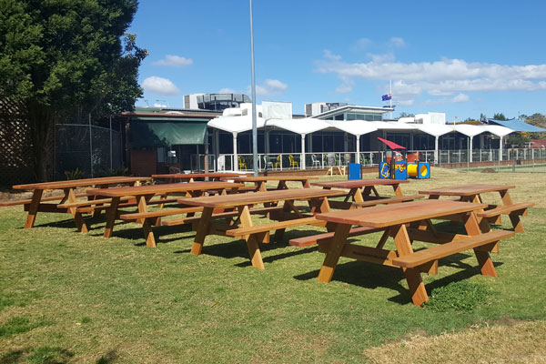 Picnic tables prepared to be put in place at a bowling club