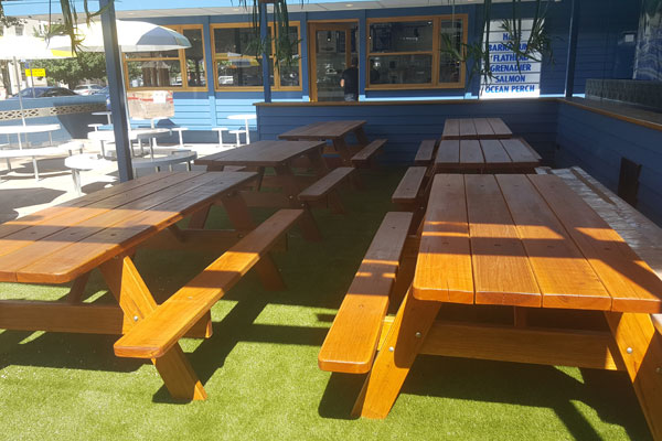 Six picnic tables at a cafe in Canberra