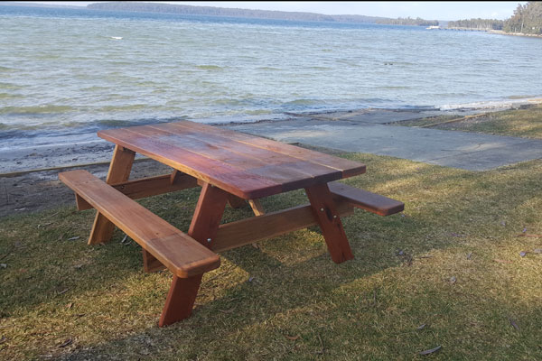 Outdoor table on the edge of a lake exposed to the elements