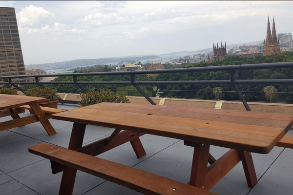 Two picnic tables on a highrise balcony in Sydney