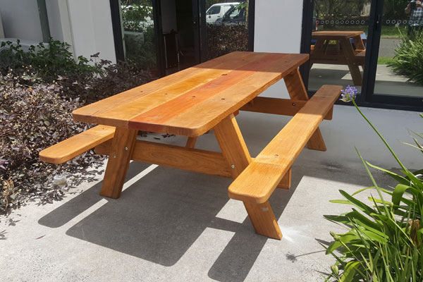 Picnic table bolted to footpath
