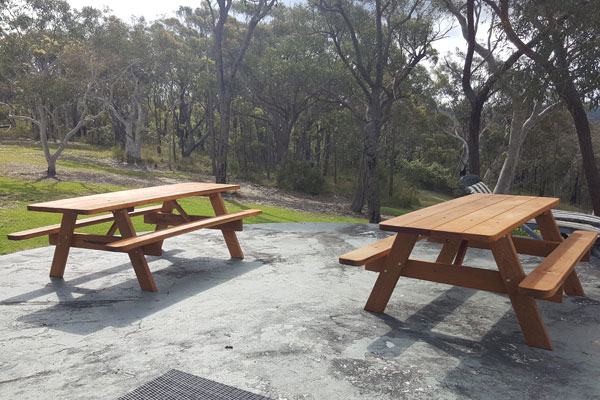 Two picnic tables on a water tank in an Australian bush setting