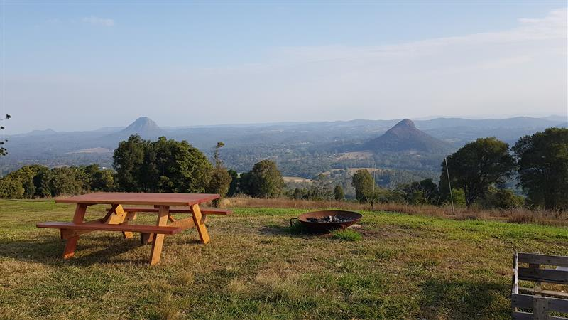 Picnic table ontop of a hill overlooking Glass House Mountains