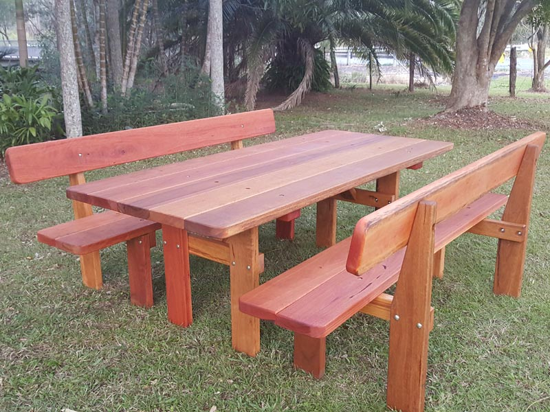 Rustic outdoor picnic table in front of a garden at Newcastle NSW