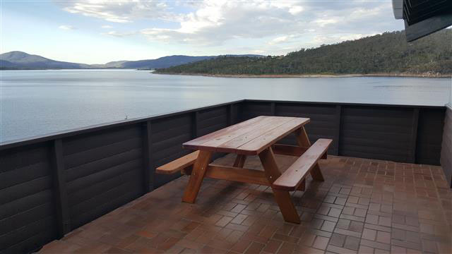 Picnic table on verandah infront of Lake Jindabyne
