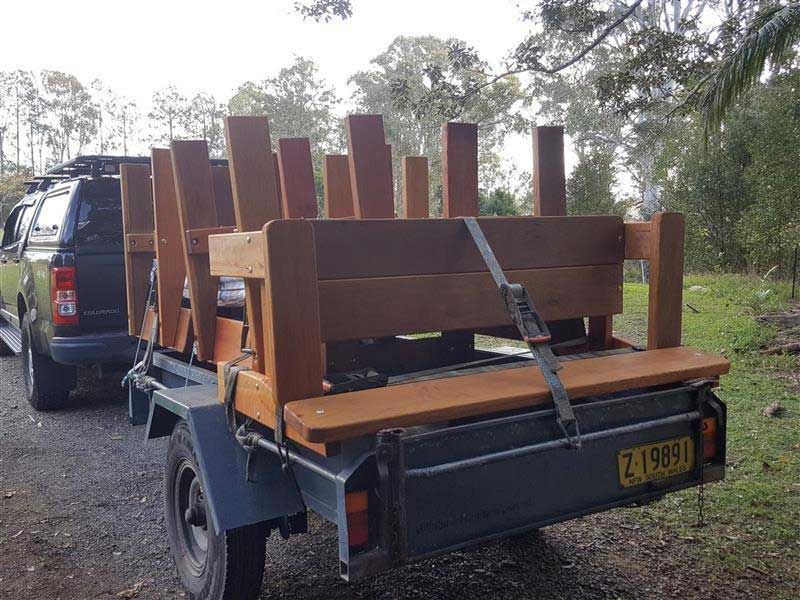 Load of wooden outdoor furniture on a box trailer