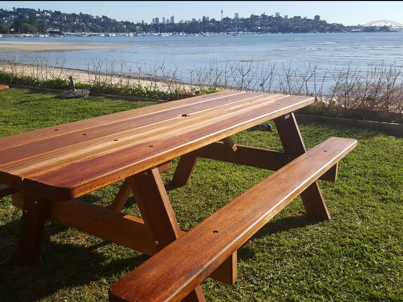 Two wooden outdoor picnic tables located at Barrangaroo wharf in Sydney