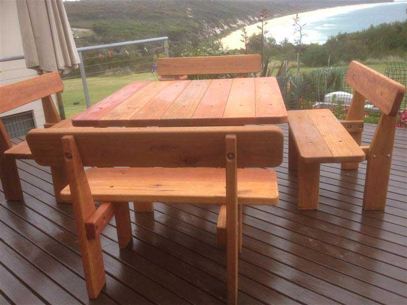 Square five piece picnic table on a balcony with a view