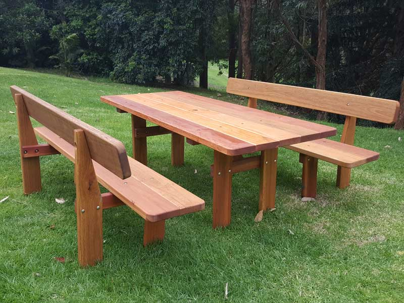 Rustic outdoor picnic table on the grass